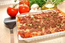 Fresh Ingredients Behind a Pan of Lasagna