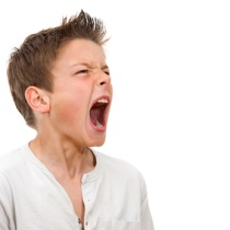 Close up portrait of boy shouting