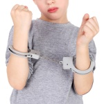 cute little boy with the hand cuffs on his hands